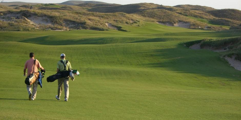 Two golfers walking the Ballyneal, Ireland course October 2008